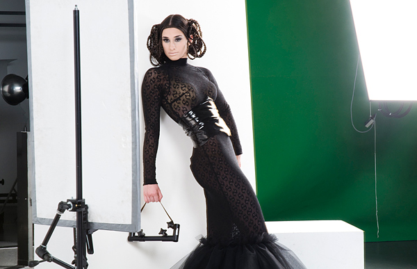 model in front of a green screen in the photo-studio